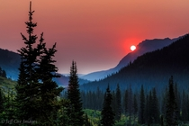 Smoky Mountain Sunrise at Upper Two Medicine Lake Photo by Jeff Cox