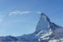 Snow and cloud streak off the top of The Matterhorn Switzerland