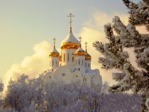 Snow caps the golden domes of the Church of the Transfiguration in the Republic of Karelia Russia