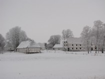 Snow-covered farm Lolland Denmark