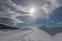 Snow covered sand dunes in Great Sand Dunes National Park Colorado