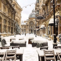 Snow covered street leading up to the CEC Bank headquarters Bucharest Romania