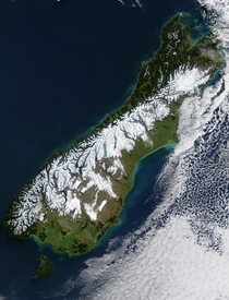 Snow delineates the escarpment formed by the Alpine Fault along the Southern Alps northwest edge near the South Island of New Zealands west coast in a satellite image showing the aftermath of a blizzard Photo Jacques Descloitres  MODIS Rapid Response Team