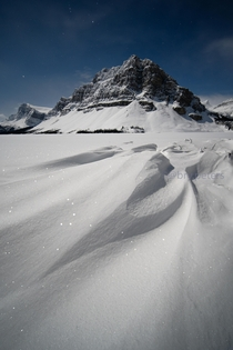 Snow drifts at Bow Lake under a full moon