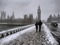 Snow falling upon Westminster Bridge and the Houses of Parliament London