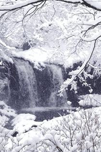 Snowing on a remote waterfall