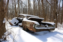 Snowy Abandoned car in woods near Chicago IL