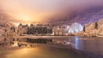 Snowy night on Lake Lenna in the Brembana Valley north of Italy  Photo by Davide Arizzi xpost from rItalyPhotos