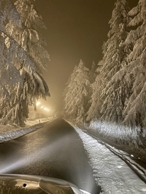 Snowy road leading to military training grounds at midnight