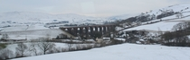 Snowy viaduct Cumbria England Taken from a train