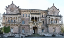 Sobrellano Palace - Comillas Spain - Built in the th cent by the first Marquis of Comillas - Designed by Joan Martorell i Montells - Constructed of stone from Carrejo Spain providing an uneven coloring that highlights the galleries and colonnades - Exteri