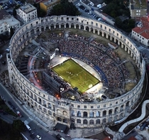 Soccer game played at the most ancient stadium in the world at Pula Arena in Croatia This is the only remaining Roman amphitheatre to have four side towers and with three Roman orders preserved It was constructed in  BC   AD and is among the worlds six la