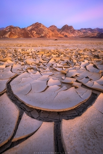Soft evening light on the now infamous mud cracks of Death Valley CA