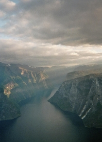 Some god rays hitting up Nryfjorden viewpoint Kalvsnesnosi -  masl Sogn og Fjordane Norway in July  - Analog film  x
