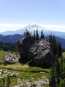 Some random massive boulders in the middle of this mountain meadow And Mt Adams Washington in the background