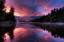 Someone mentioned we need more New Zealand photos so heres one I took at Lake Matheson near Fox Glacier at sunrise