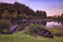Something different A beautiful view of an Abandoned Dock and Rowboat Loch Ard Trossachs Scotland by John McSporran