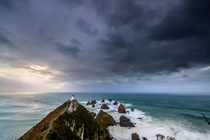 Southerly passing the Nugget Point lighthouse Catlins New Zealand