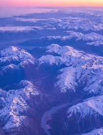 Southern Alps as seen from a plane window as we bid adieu to NZ after a wonderful trip last year Didnt spot any beacons