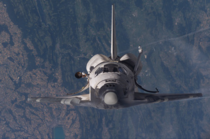 Space Shuttle approaching the International Space Station