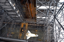 Space Shuttle Atlantis from high in the VAB with External Tank and SRBs visible in the background