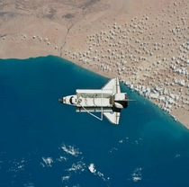 Space Shuttle Discovery departs the international Space station