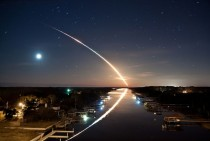 Space shuttle Endeavour STS- launches into orbit toward the east as the stars and waning crescent moon trail toward the west leaving a beautiful reflection on the Intracoastal Waterway in Ponte Vedra Florida