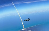 Space Shuttle Launches Behind an F-