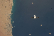 SpaceX CRS- Dragon flies beneath the ISS over the Dubai Coastline