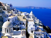 Sparkling village of Santorini against the azure sea and sky