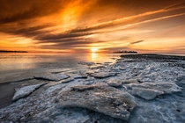 Spectacular frozen beach sunrise in Milford CT macdigital_media