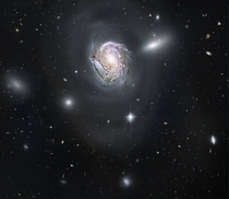 Spiral galaxy NGC  in the Coma Cluster