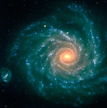 Spiral Galaxy NGC  - The central region contains older stars of a reddish color while the spiral arms are populated by young blue stars and star-forming regions