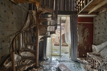 Spiral Staircase Inside a Very Decayed Abandoned Hotel