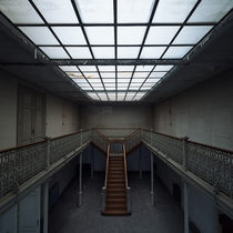 Split staircase and skylight in an abandoned university in Belgium