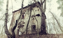 Spooky abandoned house in the forest