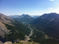 Spray Lakes Canal visibly entering Mount Lawrence Grassi from the top of Mount Rundle near Canmore Alberta
