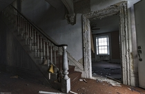 Staircase inside the front entrance of an abandoned stone house in rural Ontario OC -