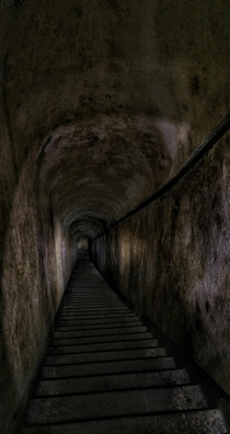 Stairway down to the artillery stand of an abandoned bunker of the Vallo Alpino fortification line in the Alps