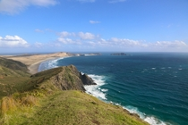 Standing atop Cape Reinga on the North Island of New Zealand feels like standing on the edge of the earth