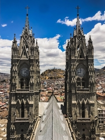 Standing atop the breathtaking Basilica del Voto Nacional in Quito Ecuador The Virgen de El Panecillo watches over the city from the hill beyond
