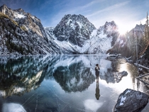 standing on frozen colchuck lake tannerwendell