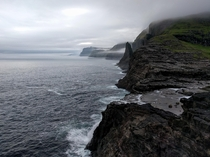 Standing on the edge of the world Lake Srvgsvatn Faroe Islands