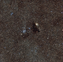 Star cluster NGC  and Barnard  a strangely dark gas cloud Zoom in and youre actually able to see countless individual stars Keep in mind each star is still light years apart from each other