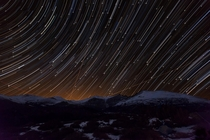 Star Trails and Airplanes over Mt Evans in Colorado The light behind the mountains is from the city of Denver Photo by Richard Steinberger
