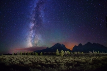 Starry night over Grand Teton Range Jenny Lake Wyoming  by Royce Bair