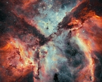 Stars Gas and Dust Battle in the Carina Nebula