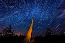 Stars trail above a metal sculpture created by Helga Natz in Guysborough County