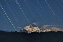 Startrail over Kanchenjunga It rained for almost two days without a hint of blue skies but on the third day I got a small window to capture Kanchenjunga  m  under Moonlight  Mount Kanchenjunga was considered as the highest peak of the world until Gangtok