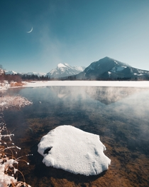 Steam rises from Vermillion Lakes in Banff Alberta